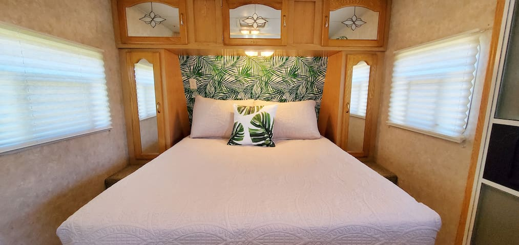 Full size bed with white linens. Very comfortable mattress and fluffy pillows. Storage on both sides and above the bed.