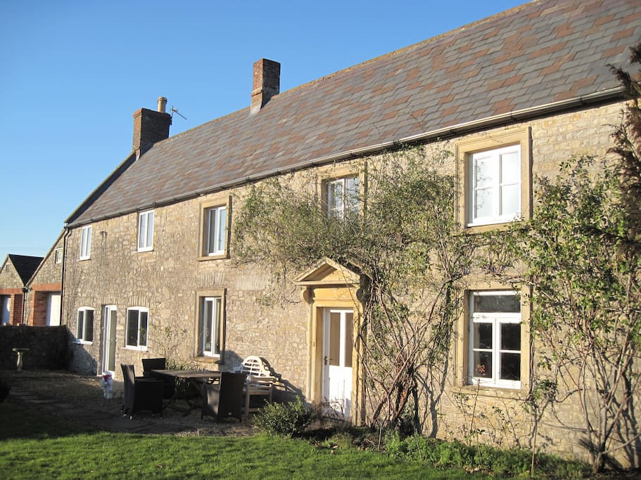 The front of the 18th century large farmhouse leading directly to the yard with ample parking