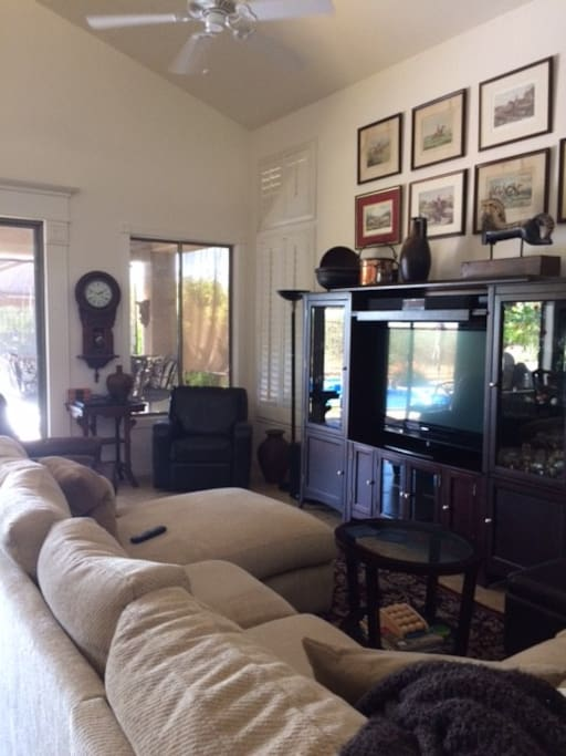 Great room with 2 recliners, overstuffed sofa with chaise lounge and TV