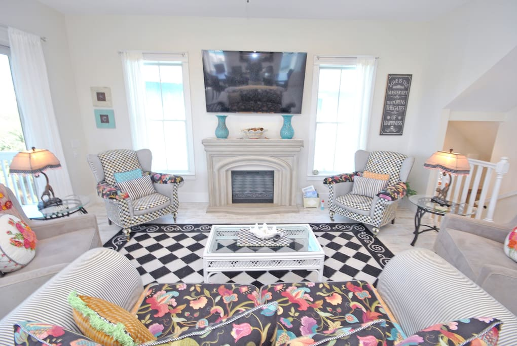 Bright and colorful, high end mckenzie childs living room.