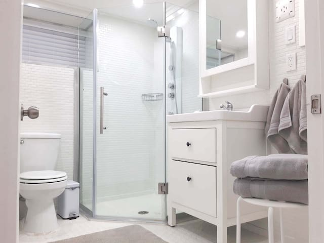 Bathroom with walk-in shower.