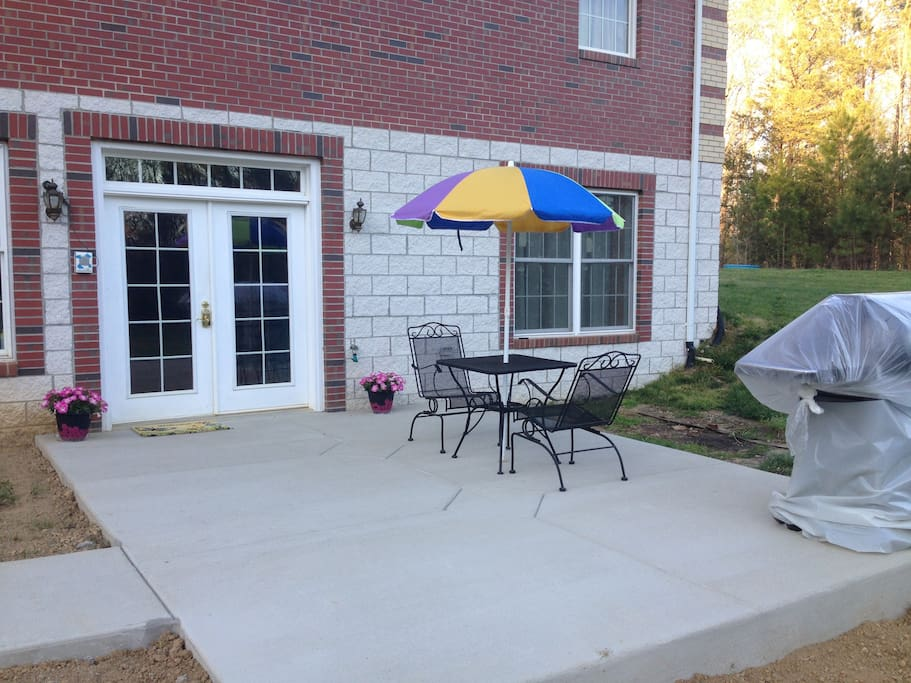 Private entrance, table, rocking chairs for relaxing and enjoying nature.