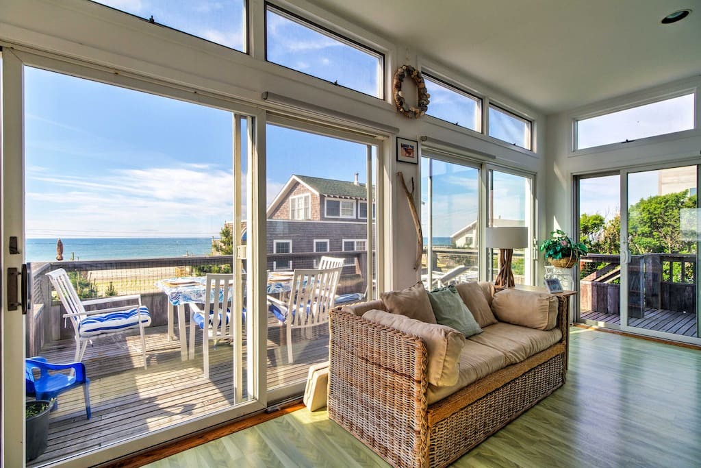 The large windows in the living room provide amazing ocean and beach views.