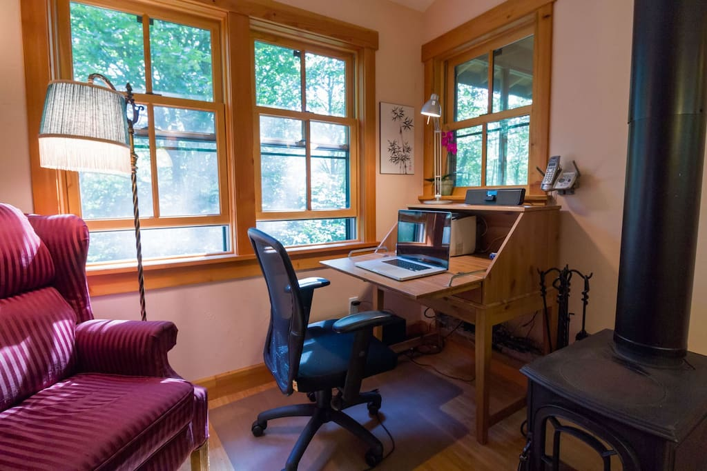 The drop-front desk gives you a place to write and is home to a printer and the WiFi router. (Photo by Camille Meehan)