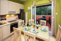 FULLY EQUIPPED KITCHEN - DINING AREA OPENED TO THE COVERED TERRACE
