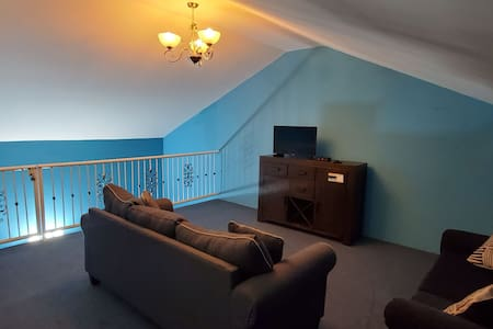Spacious upper level one bedroom apt with loft.