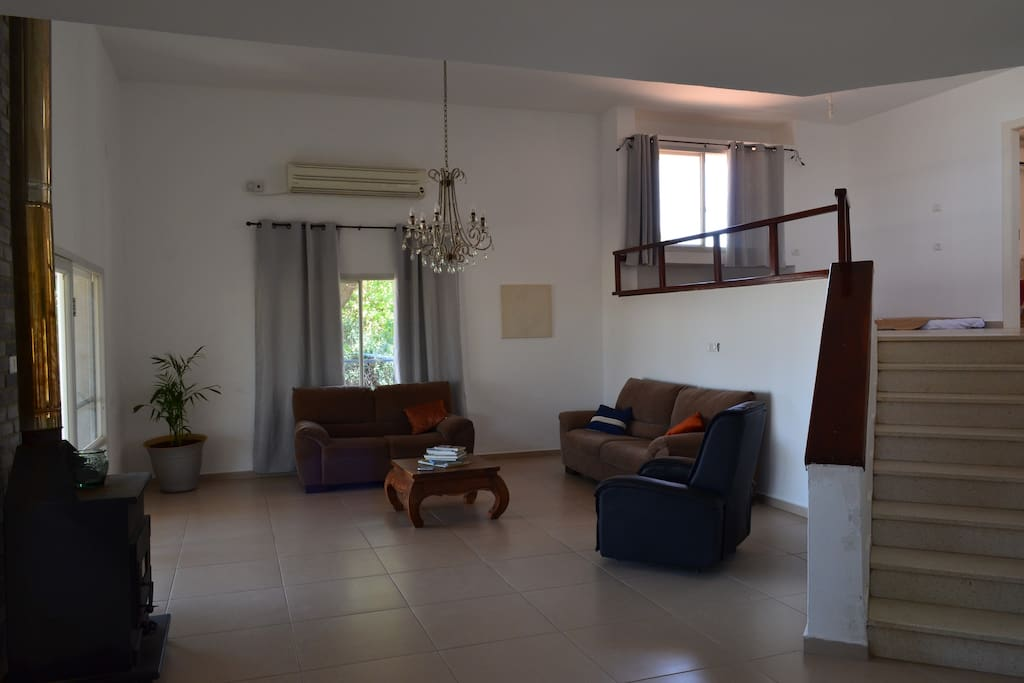 view from the dining area of the living room and stairs leading to bedrooms