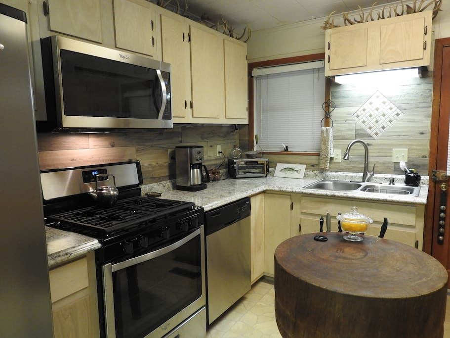Kitchen with all new stainless steel appliances, 5 burner stove