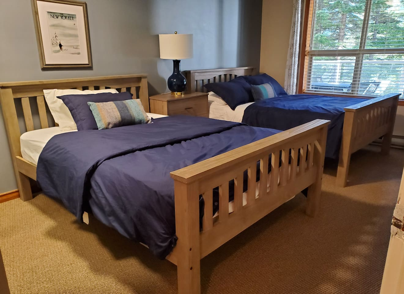 Reconfigured second bedroom is comfortable for up to four guests.