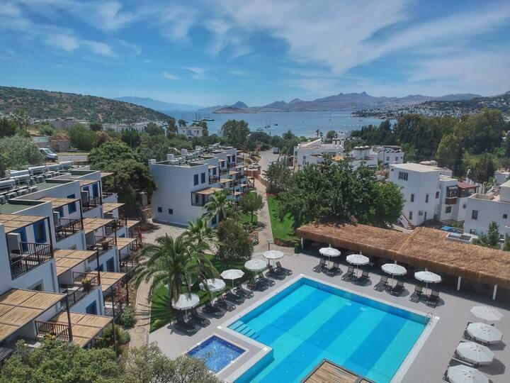 Kiralık şık 1+1 daire, Özel Plaj, Havuz,free wifi