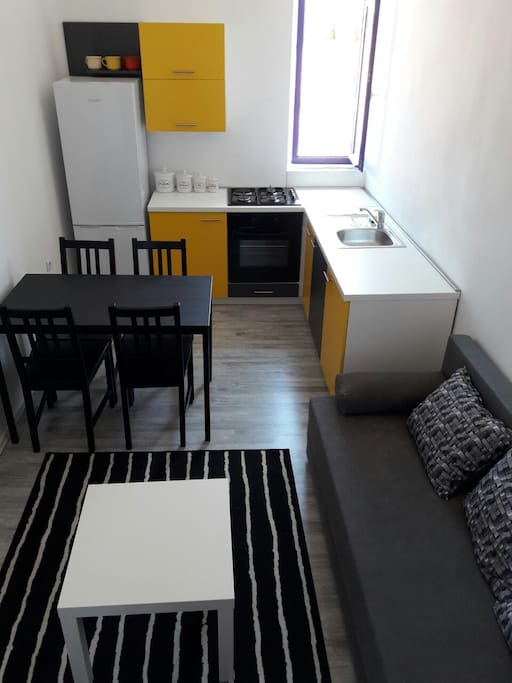 Kitchen with dining area and living room with sat tv