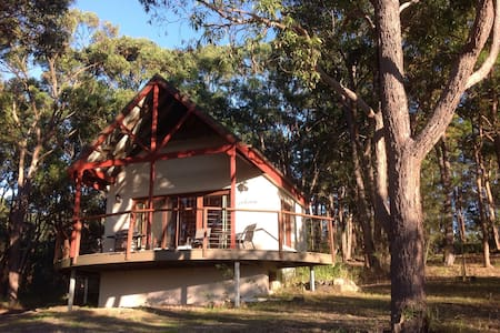Private cabin in bush setting with water views