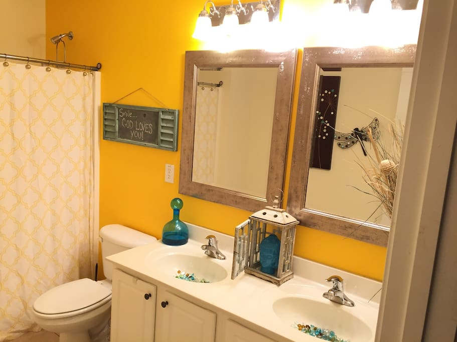 Private bathroom with a double vanity sink