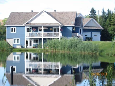 759 logement 4 1/2 vu sur lac La campagne en ville