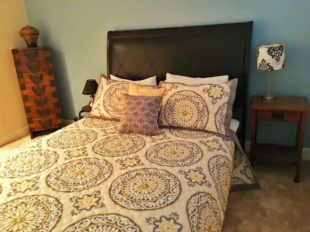 Comfortable queen bed with memory foam topper.