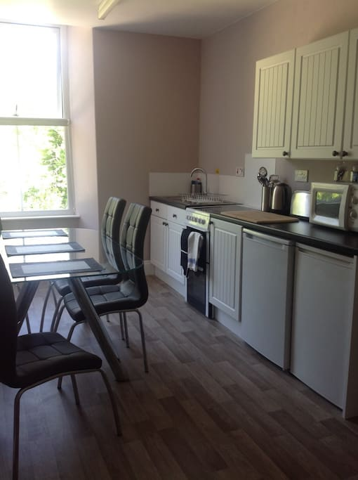 Fully fitted dining kitchen with great views over the fells, all the required appliances including electric oven, microwave, fridge, freezer and dining table.