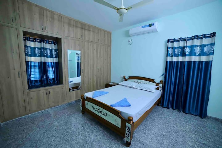 Our AC Second bedroom with private bathroom. Fresh bedsheets and pillow covers. Extra bed for one more person to sleep