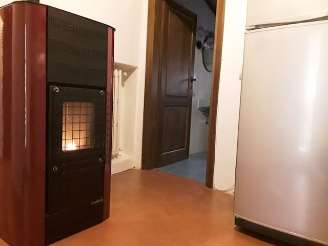 Pellet heating system. The heat is transmitted to all the radiators from the apartment.