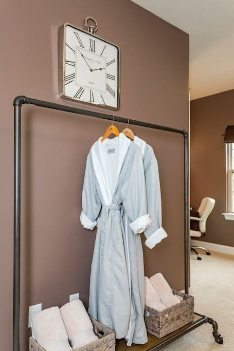Spa robes and plush rolled towels make for a luxurious stay.