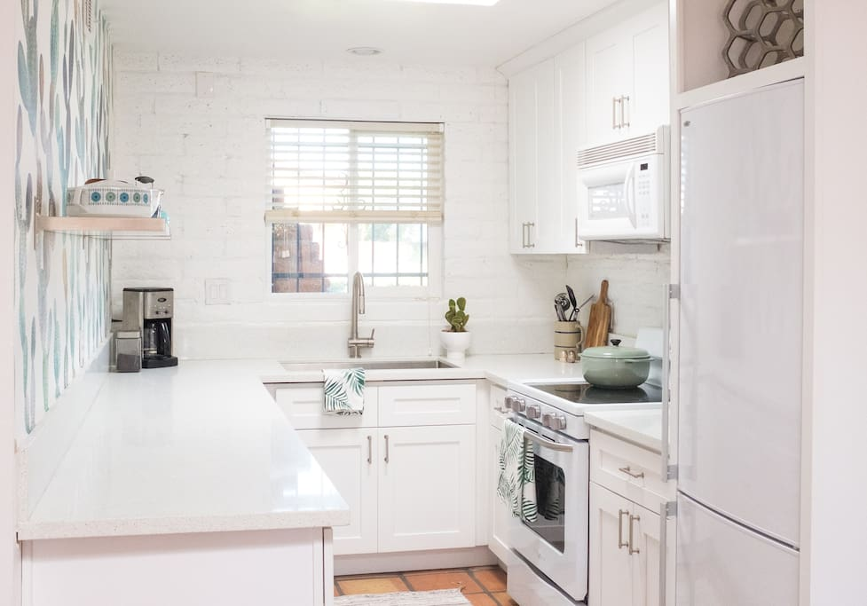 Fully stocked kitchen with everything you need to make great meals! Includes coffee maker, pots and pans, baking dishes, cutting boards, cutlery that actually CUT, wine glasses, coffee mugs, toaster, teapot, hand towels, Magic Bullet blender and much more.