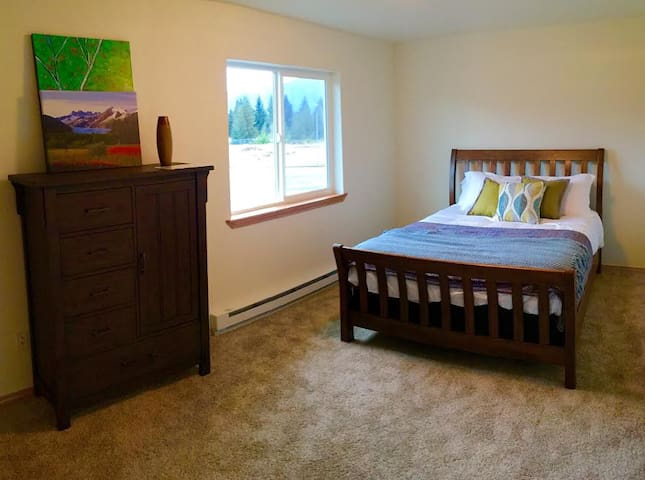 First room with queen bed.