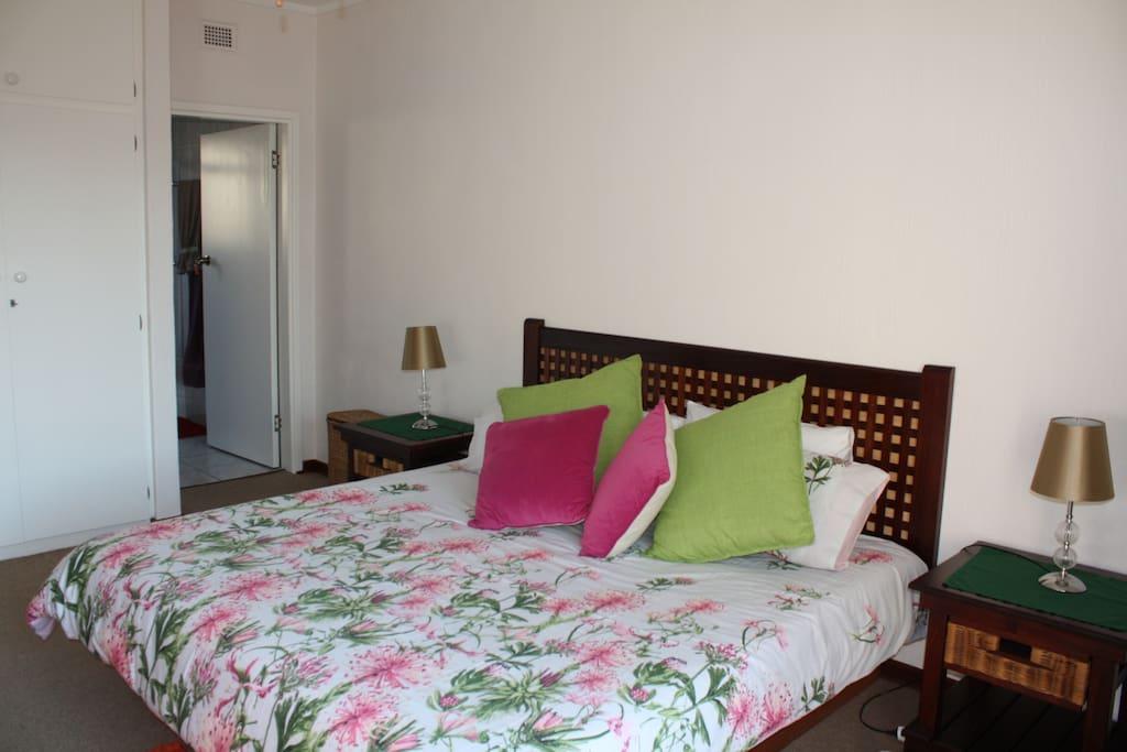 Main bedroom king size bed and en-suite bathroom