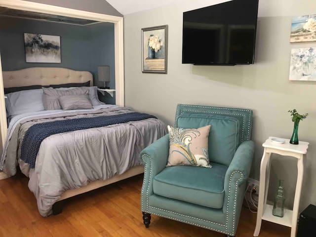 After a busy day, climb into this brand new bed with  all new linens and pillows 1000 count.