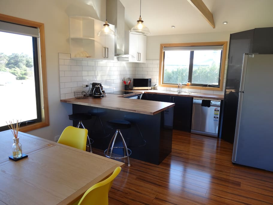 Colour and light filled open plan living/dining and kitchen.