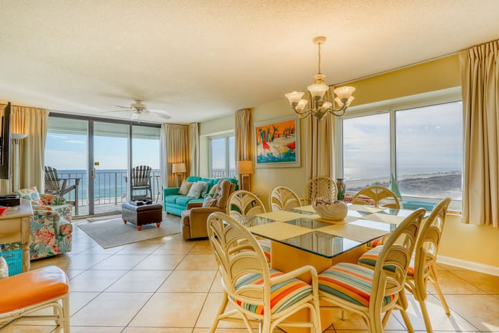Beachfront condo w/ a spacious living area, full kitchen, & community pools!