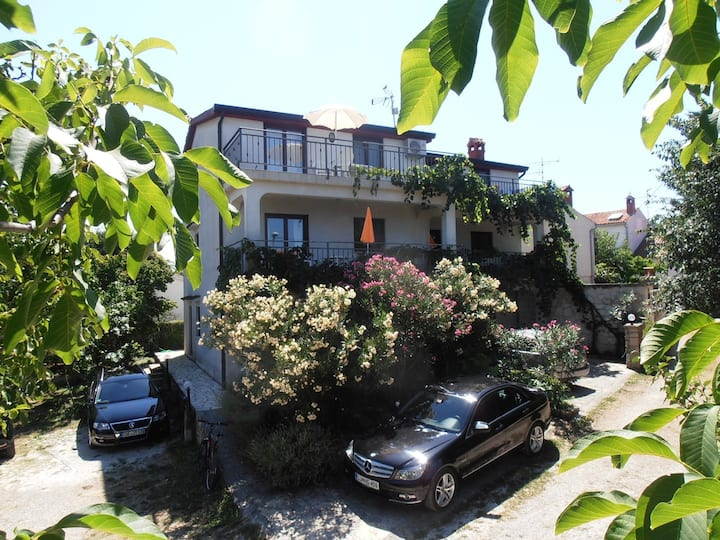 House Coki / Two bedroom apartment with large terrace and garden view