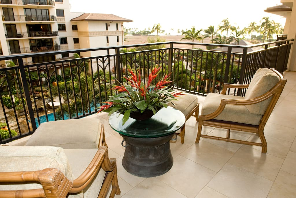 Lanai off dining and kitchen, with view over lap pool and out to the ocean