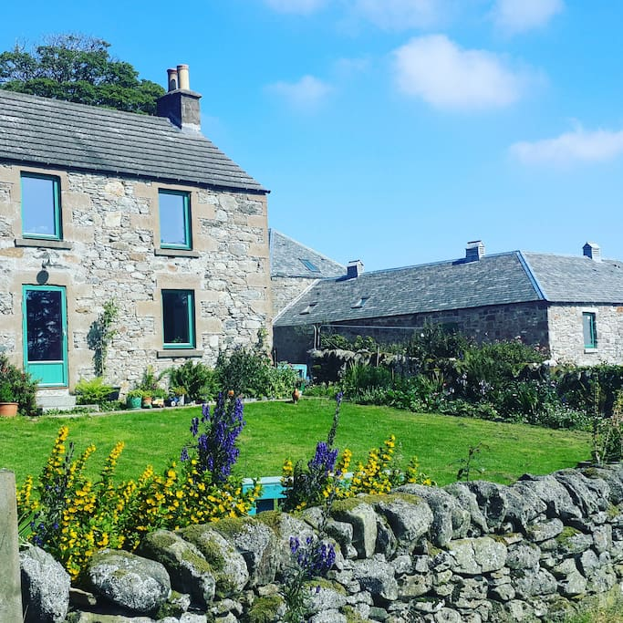 Our house is on the left and the steading is on the right where you will stay