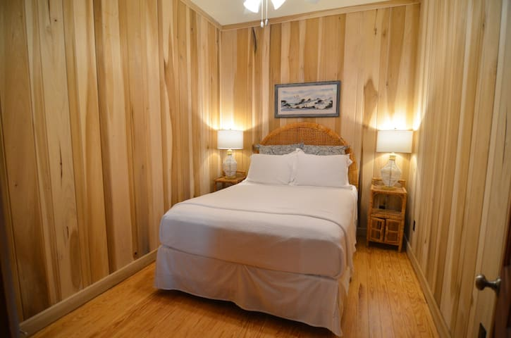 Private queen bedroom located in the heart of the home is a sleeper's dream