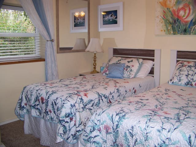 Small, quiet, comfortable room with 2 twin beds on ground floor level.
