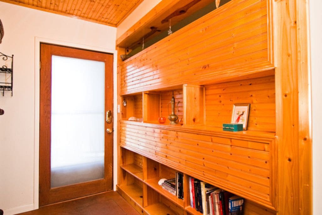 Knotty pine shelves for shoes and books - take off your shoes and rest!