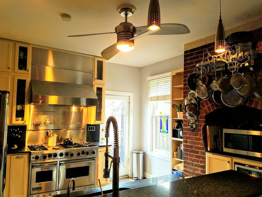 Viking six-burner range with a griddle. Nothing like it. Kitchen has everything you need to host a dinner party. Or just enough to have coffee and snacks in between D.C. events. The counter with seating for four lets the cook hold court.