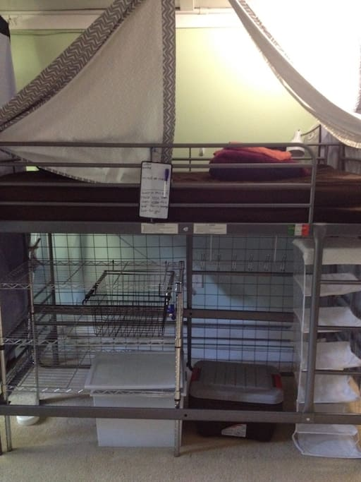 View of a Loft bed. Loft beds have storage directly underneath the bed for that guest to use.