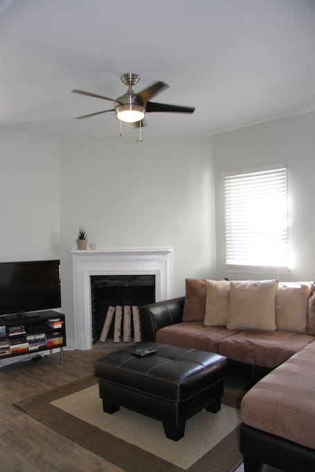 living room: couch, HD TV, Xfinity DVR cable box.