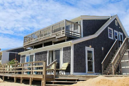 Step off the Deck on to the sand and waves!