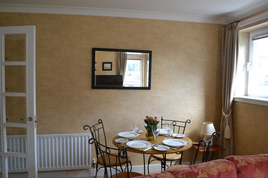The large living room has a dining area with table for four