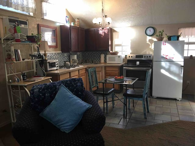 With The Roadrunner Suite, you get a full apt. Open concept- living room, kitchen, bathroom with small shower. You have vaulted ceilings and great light with many windows. You have a porch to drink coffee or whatever you desire to do.