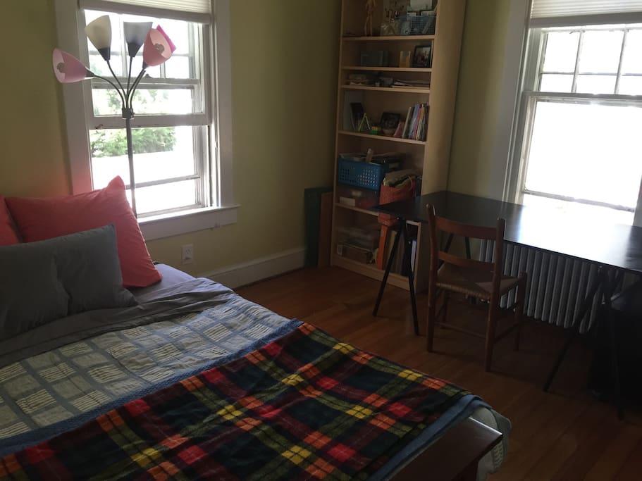 Guest room: king size futon, desk, closet.