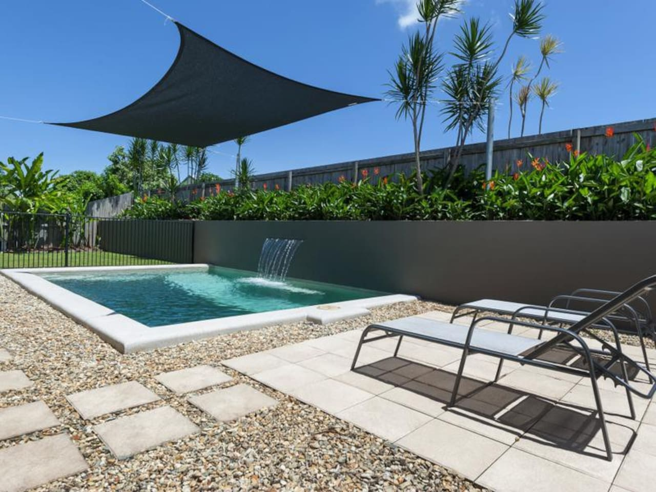 A deliciously cool swimming pool featuring a calming water feature make this outdoor space a very private oasis….a perfect entertainer or relaxing sanctuary.