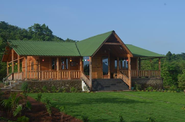 LoveNest Loghouse, on an 8-acre farm on a hill
