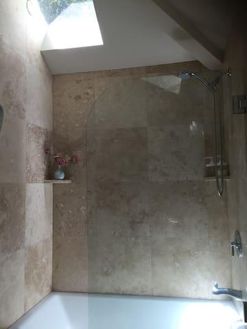 Bathtub with heated floors.