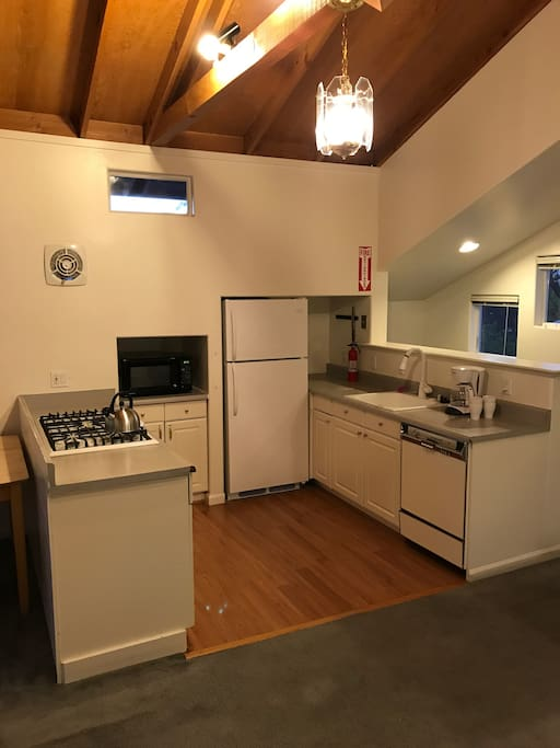 Kitchen with gas stove, microwave, fridge, dishwasher, sink. Please use that wall fan when cooking.