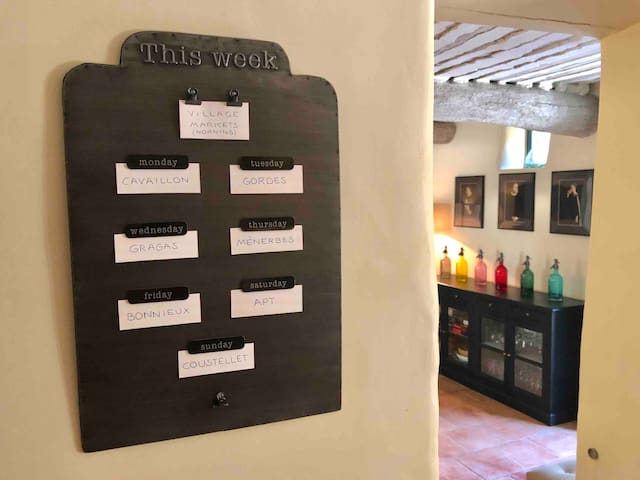 Kitchen with list of Provence Village markets by day of the week