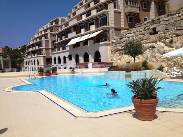 Pool area and apartments