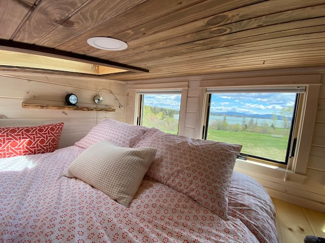The large loft bedroom, with a skylight and a view