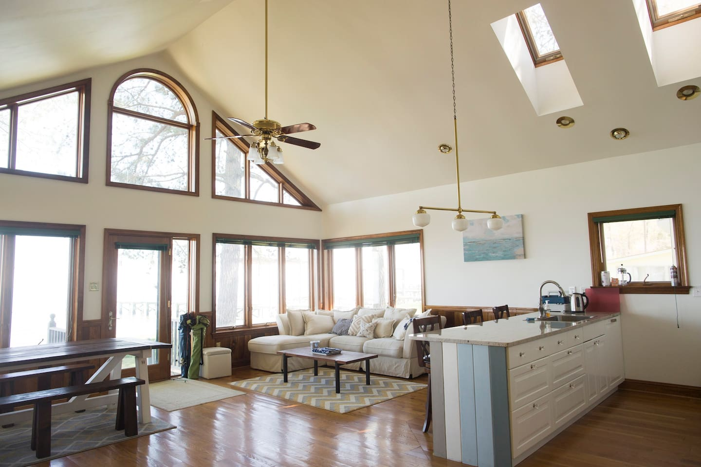 The original owner had a custom woodworking business in Bethesda, MD. The wood floors and paneling are beautiful accents to the cottage's spacious open-concept living space.